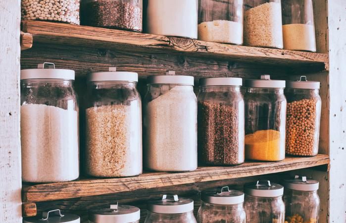 Jars of ingredients on wooden shelves