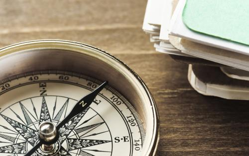 Compass and papers on a table