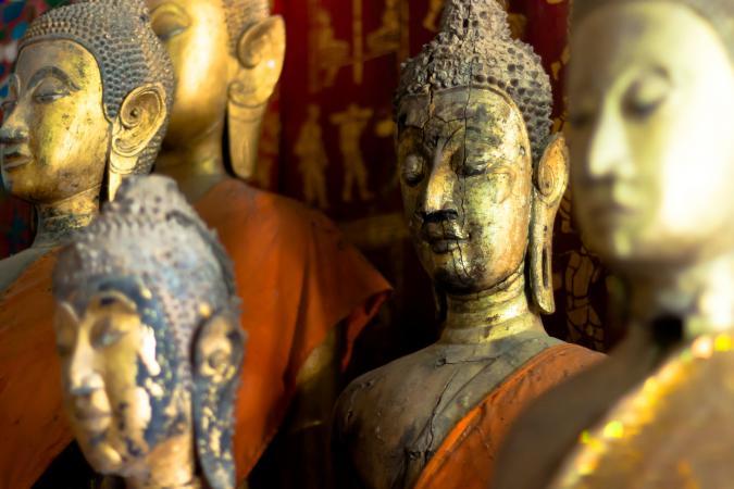 five golden buddha statues