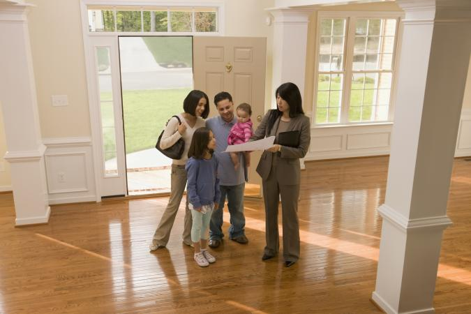 Family examining floor plan