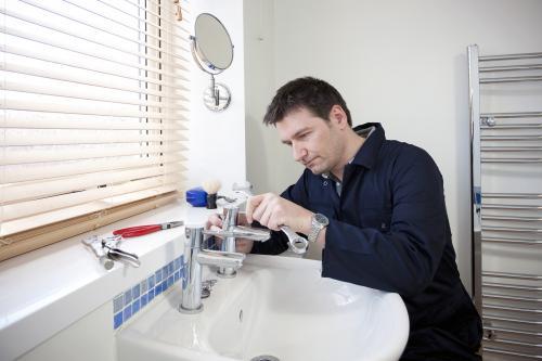 Main repairing a faucet