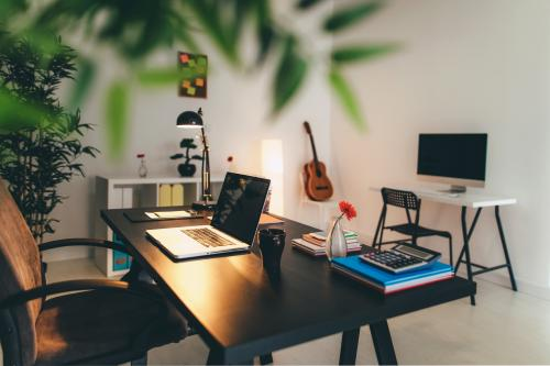 Black painted desk in home office
