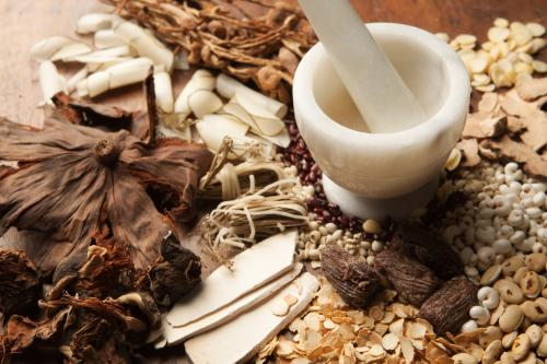 Chinese medicine herbs with mortar and pestle