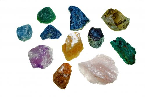 Rough gemstones on white background