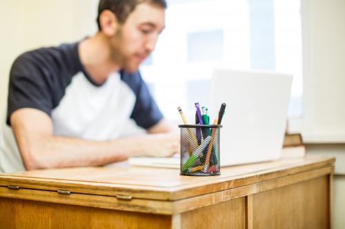 Young man at dorm desk