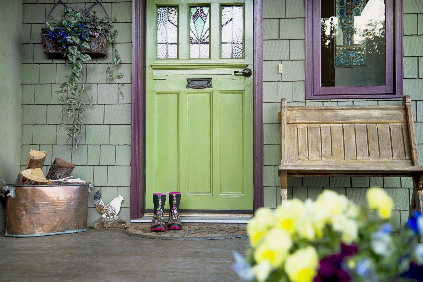 Welcome mat at green painted door