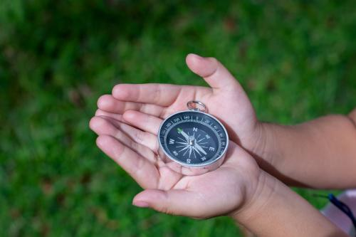 hands holding a compass