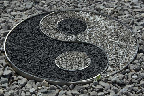 Yin yang sign in garden rocks