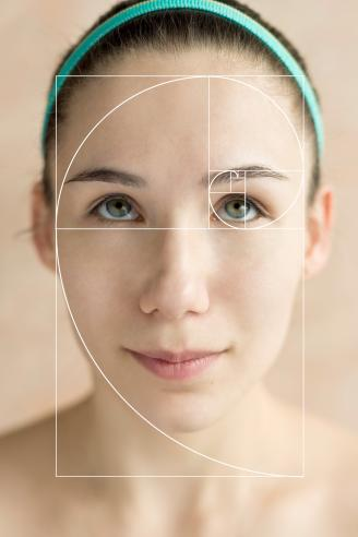Golden spiral overlay on female face