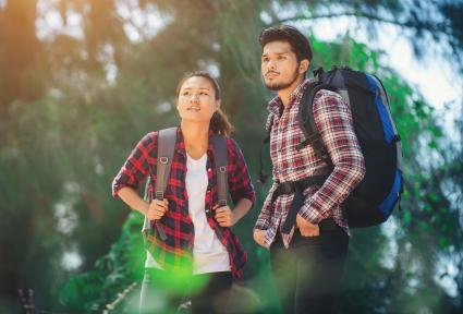 couple in layered plaid shirts