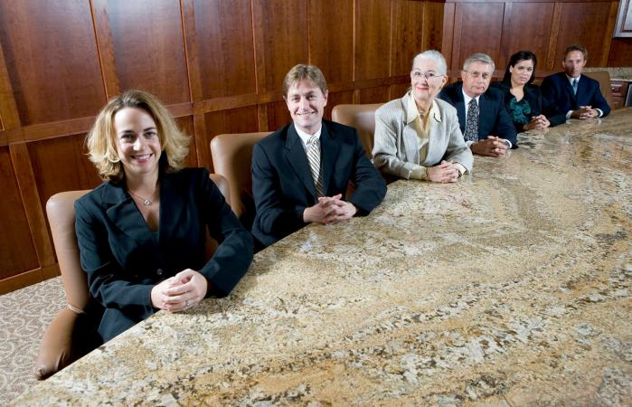 business people sitting by conference table