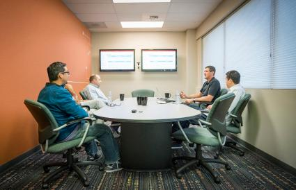 Businessmen meeting in conference room