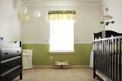 A bee themed neutral nursery room with shades