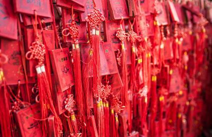 Hanging red wooden prayer blocks