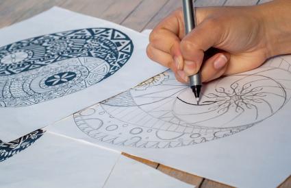 Hand of woman drawing yin yang