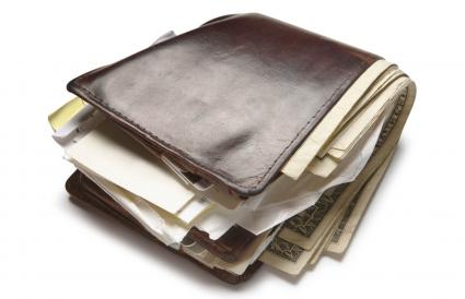 old wallet stuffed with money and papers