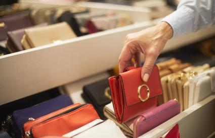woman picking up a red wallet