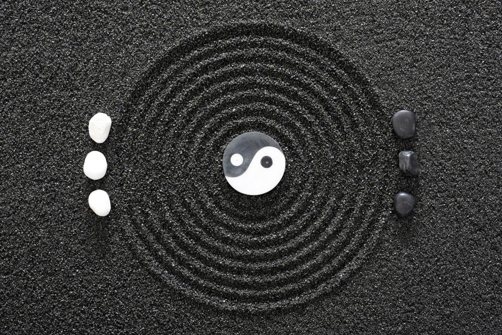 Japanese ZEN garden in black sand with Yin and Yang