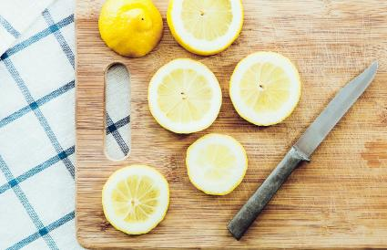 Sliced lemon on wooden cutting board