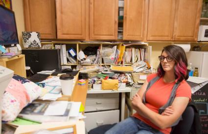 woman sitting in messy office