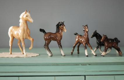 Five horse figurines