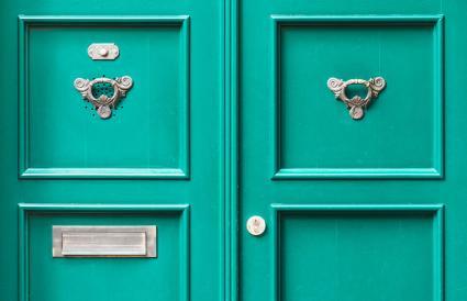 green front door with metal plaque