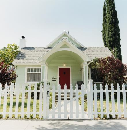 Green house with picket fence
