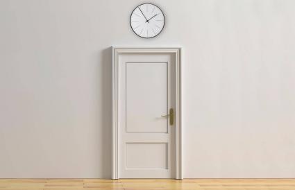 Clock above door
