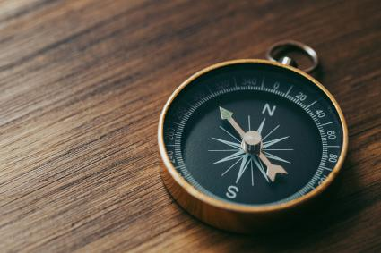 High Angle View Of Compass On Table