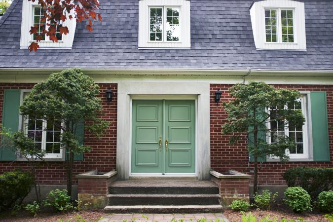 House with pale green front door