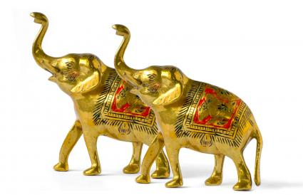 statue of two golden elephants