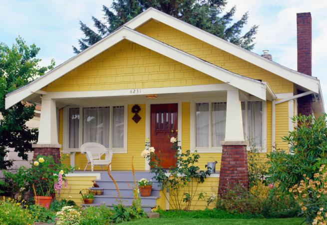 Yellow bungalow style house with garden