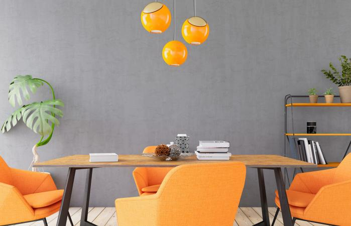 Concerete Wall with Table and Orange Decors