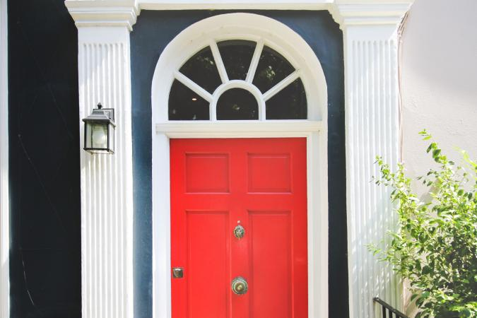 Front view of a red door in a row house