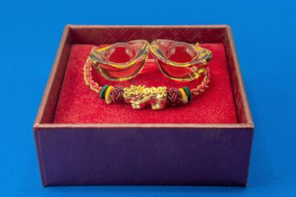 Gold pixiu with thread bracelet and yellow glass yuan bao ancient chinese money in red box