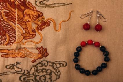 Obsidian stone bracelet dragon textile background
