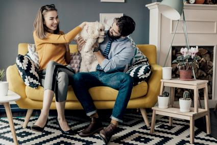 Cozy living room with couple and dog