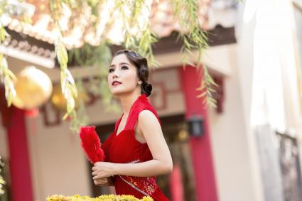 Chinese woman in red dress traditional in Chinese temple