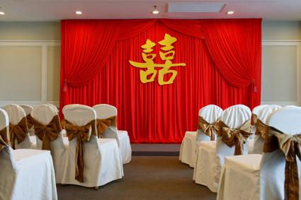 Decoration of Chinese wedding tea ceremony hall with double happiness symbol as background