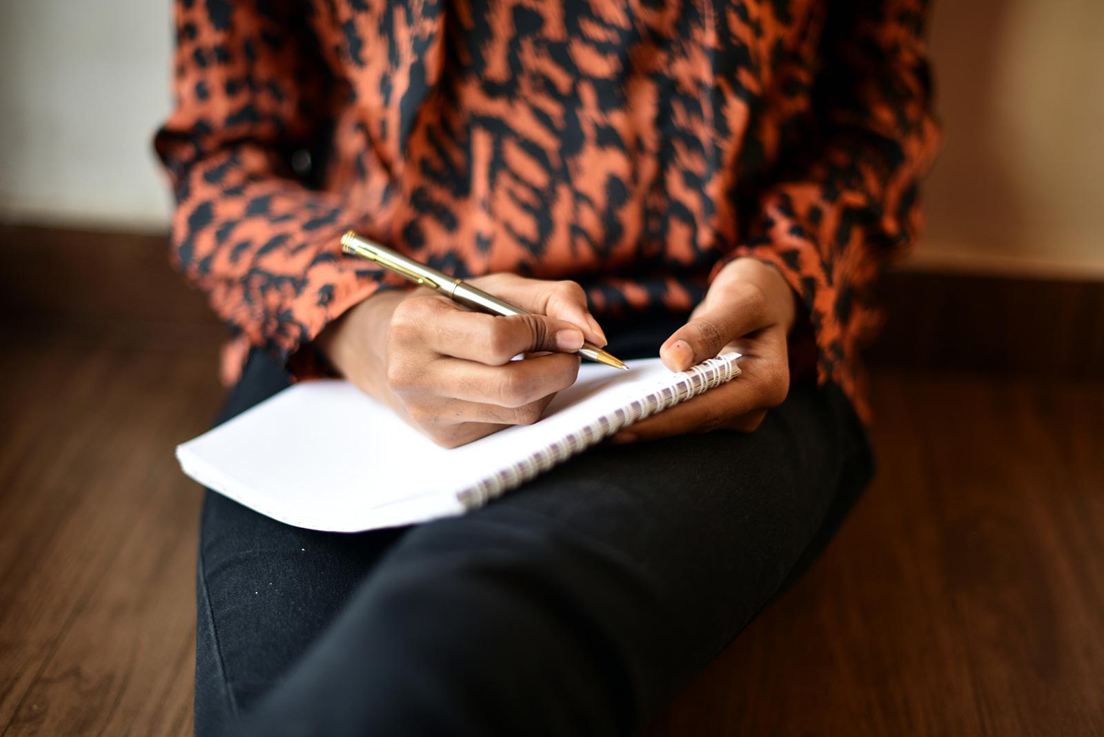 woman-writing-on-pad.jpg