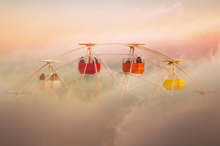 https://cf.ltkcdn.net/freelance-writing/images/slide/248031-850x567-ferris-wheel-emerging-through-clouds.jpg