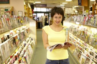 Woman with a magazine at a bookstore