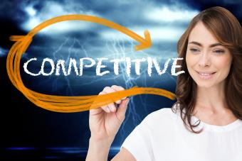Woman writing competitive