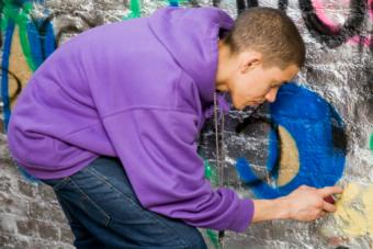 Teenager doing graffiti