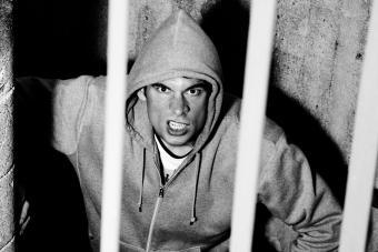 https://cf.ltkcdn.net/freelance-writing/images/slide/245572-850x566-angry-man-behind-bars.jpg