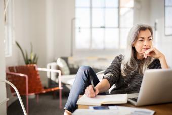 https://cf.ltkcdn.net/freelance-writing/images/slide/245695-850x567-woman-writing-in-journal.jpg