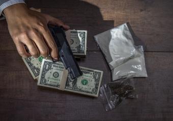 https://cf.ltkcdn.net/freelance-writing/images/slide/250933-850x595-11_Drugs_Money.jpg