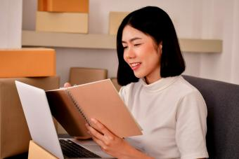 Woman reading her self published book
