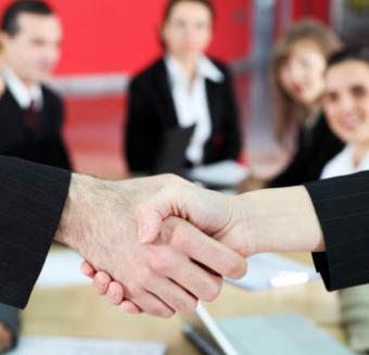 Writers shaking hands at a professional development organization