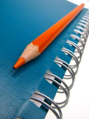 Colored pencil and notebook for writing anecdotes
